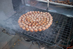 Grilled Thai sausages on the stove on the beside street. Street food on the Thailand Stock Images