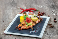 Grilled tiger prawns with grilled vegetables on a square plate Royalty Free Stock Photography