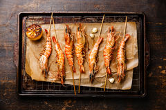 Grilled Tiger prawns on skewers Royalty Free Stock Image