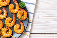 Grilled tiger shrimps skewers with lemon. Seafood style stock photo