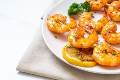 Grilled tiger shrimps skewers with lemon. Seafood style stock images
