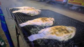 Grilled Tilapia fish in street market of Thailand.  stock video footage