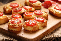 Grilled toast with cheese and tomatoes Stock Photo