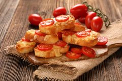 Grilled toast with cheese and tomatoes Stock Photos