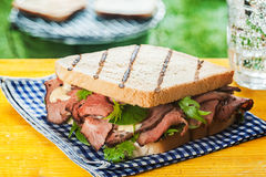 Grilled toasted sandwich with rare roast beef Stock Photography