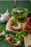 Grilled toasts with pesto Royalty Free Stock Images