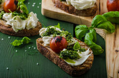 Grilled toasts with pesto Stock Photos
