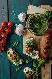 Grilled toasts with pesto Royalty Free Stock Image