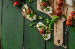 Grilled toasts with pesto Stock Images