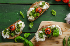 Grilled toasts with pesto Stock Image