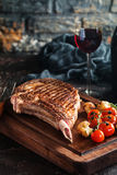 Grilled tomahawk beef steak Royalty Free Stock Images