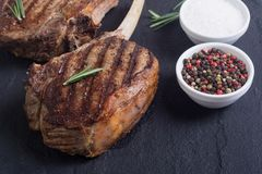 Grilled tomahawk steak. Beef . With rosemary Royalty Free Stock Photography