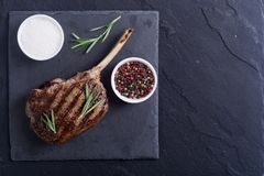 Grilled tomahawk steak. Beef . With rosemary Royalty Free Stock Photo