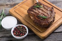 Grilled tomahawk steak. Beef . With rosemary Stock Images
