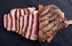 Grilled tomahawk steak. Beef . With rosemary Stock Image