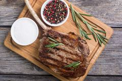 Grilled tomahawk steak. Beef . With rosemary Stock Photos