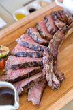 Grilled tomahawk steak. On wooden plate stock photography