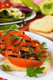 Grilled tomato. Served on toasted bread with rosemary and parsley Stock Images