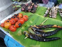 Grilled tomato and green chilli for Nam Prik Chilli sauce Royalty Free Stock Image
