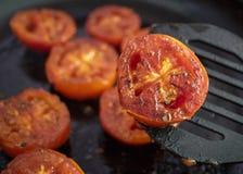 Grilled tomato on pan stock photos