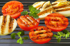 Grilled tomatoes and onions Royalty Free Stock Photos