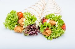 Grilled tortilla with chicken, mayo and tomato ketchuGrilled tortilla chicken, lettuce, homemade mayo and barbeque sauce Royalty Free Stock Photography