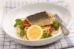 Grilled trout fillet on spaghetti with tomato sauce Stock Image