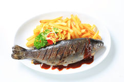 Grilled trout and French fries Royalty Free Stock Photos