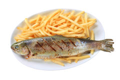 Grilled trout with French fries Royalty Free Stock Photos