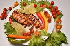 Grilled trout with fresh Greens. And vegetables Stock Photo