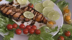 Grilled trout with fresh Greens. And vegetables stock video footage