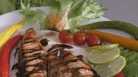 Grilled trout with fresh Greens. And vegetables stock footage