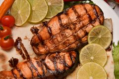 Grilled trout with fresh Greens. And vegetables Stock Image