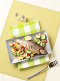 Grilled trout and mixed vegetables Stock Photo
