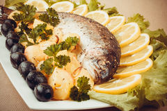 Grilled trout with olive, potato and vegetables Royalty Free Stock Images