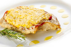 Grilled trout steak with cheese and prosciutto. 1 Stock Photography