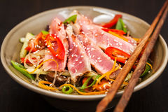Grilled tuna and  asian rice glass noodles with vegetables Stock Photos