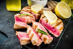 Grilled tuna fish steaks royalty free stock photos