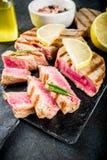 Grilled tuna fish steaks stock photo
