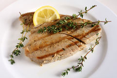 Grilled tuna and lemon wedge Royalty Free Stock Images