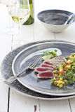 Grilled tuna with mango salsa. Grilled or seared tuna with mango and avocado salsa royalty free stock photo