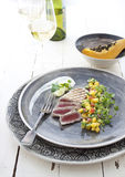 Grilled tuna with mango salsa. Grilled or seared tuna with mango and avocado salsa stock photo