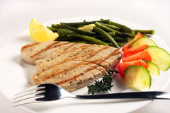 Grilled tuna meal with fork Stock Images