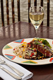 Grilled Tuna Plate Oceanside. Dish with grilled tuna fillets over rice with vegetables and red wine reduction and Hollandaise sauce Stock Images