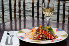 Grilled Tuna Plate with White Wine. Dish with grilled tuna fillets over rice with vegetables and red wine reduction and Hollandaise sauce Stock Images