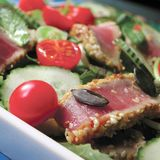 Grilled tuna with sesame and side salad. Served in Italy Stock Photography