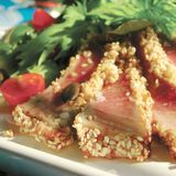 Grilled tuna with sesame and side salad. Served in Italy Stock Images
