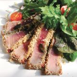 Grilled tuna with sesame and side salad. Served in Italy Stock Photo