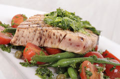 Grilled tuna steak with bean and tomato salad Royalty Free Stock Photos