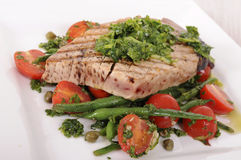Grilled tuna steak with beans and tomato salad. Grilled tuna steak with green beans and cherry tomatoes salad Royalty Free Stock Photo